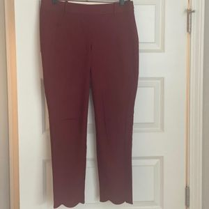 Burgundy scalloped cropped pants.